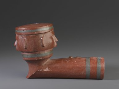 Sisseton, Sioux. <em>Inlaid Pipe Bowl with Two Faces</em>, early 19th century. Catlinite (pipestone), lead, 3 x 5 x 3 in. (7.6 x 12.7 x 7.6 cm). Brooklyn Museum, Henry L. Batterman Fund and the Frank Sherman Benson Fund, 50.67.104. Creative Commons-BY (Photo: Brooklyn Museum, 50.67.104_profile_PS9.jpg)