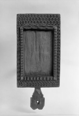 Sioux. <em>Chief's Looking Glass Frame</em>, early 19th century. Wood, 7 x 3 1/4 in. (17.8 x 8.3 cm). Brooklyn Museum, Henry L. Batterman Fund and the Frank Sherman Benson Fund, 50.67.108. Creative Commons-BY (Photo: Brooklyn Museum, 50.67.108_acetate_bw.jpg)