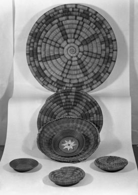 Apache. <em>Coiled Dish-shaped Basket with Geometric Decorations</em>, late 19th century. Plant fiber, 12 3/4 x 12 3/4 in. (32.4 x 32.4 cm). Brooklyn Museum, Henry L. Batterman Fund and the Frank Sherman Benson Fund, 50.67.122. Creative Commons-BY (Photo: , 50.67.123_50.67.122_50.67.125_50.67.126_50.67.124a-b_glass_bw.jpg)