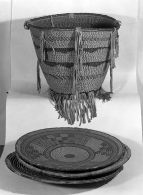 Apache. <em>Basket with Geometric Designs</em>, late 19th century. Rush, grass, a: 18 in. diam. Brooklyn Museum, Henry L. Batterman Fund and the Frank Sherman Benson Fund, 50.67.130a-b. Creative Commons-BY (Photo: , 50.67.128_50.67.129_50.67.130a-b_group_glass_bw.jpg)