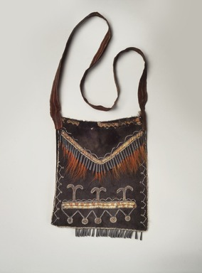 Delaware. <em>Black Pouch</em>, late 18th-early 19th century. Buckskin, porcupine quills, tin, deer hair, ribbon, glass beads, commercial cloth, 10 x 8 1/2 in. (25.4 x 21.6 cm). Brooklyn Museum, Henry L. Batterman Fund and the Frank Sherman Benson Fund, 50.67.15. Creative Commons-BY (Photo: Brooklyn Museum, 50.67.15_edited.jpg)