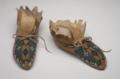Native American (possibly Sarsi). <em>Pair of Moccasins</em>, 19th century. Hide, glass beads, 4 x 3 3/4 x 9 1/2 in. (10.2 x 9.5 x 24.1 cm). Brooklyn Museum, Henry L. Batterman Fund and Frank Sherman Benson Fund, 50.67.19a-b. Creative Commons-BY (Photo: Brooklyn Museum, 50.67.19a-b.jpg)