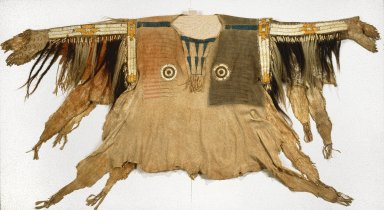 Sioux. <em>Shirt for Chief's War Dress</em>, 19th century. Buckskin, pony beads, porcupine quills, maidenhair fern stem, human hair, horsehair, dye, feather, 44 x 68 in. (111.8 x 172.7 cm). Brooklyn Museum, Henry L. Batterman Fund and Frank Sherman Benson Fund, 50.67.1a. Creative Commons-BY (Photo: Brooklyn Museum, 50.67.1a_edited_SL1.jpg)
