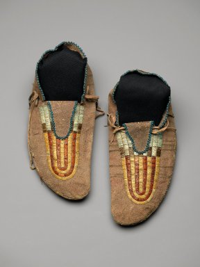 Sioux. <em>Pair of Moccasins</em>, early 19th century. Hide, beads, bird quills, porcupine quills, tin, deer hair, sinew, pigment, 4 x 5 x 11 in. (10.2 x 12.7 x 27.9 cm). Brooklyn Museum, Henry L. Batterman Fund and Frank Sherman Benson Fund, 50.67.23a-b. Creative Commons-BY (Photo: Brooklyn Museum, 50.67.23a-b_PS2.jpg)