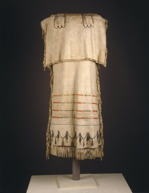 Probably Yanktonai, Nakota, Sioux. <em>Strap Dress with Red and Green Embroidery</em>, early 19th century. Emulsion cured buckskin, dyed porcupine quills, glass beads, tin and copper tinklers, thread (cotton or linen), sinew and pigment, 46 x 21 in.  (116.8 x 53.3 cm). Brooklyn Museum, Henry L. Batterman Fund and Frank Sherman Benson Fund, 50.67.2. Creative Commons-BY (Photo: Brooklyn Museum, 50.67.2_SL1.jpg)
