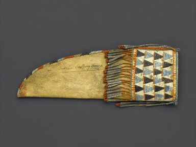 Eastern, Sioux. <em>Knife Sheath</em>, early 19th century. Rawhide, buckskin, porcupine quills, tin, sinew, thread, 9 1/2 x 3 1/4 in. (24.1 x 8.3 cm). Brooklyn Museum, Henry L. Batterman Fund and the Frank Sherman Benson Fund, 50.67.41. Creative Commons-BY (Photo: Brooklyn Museum, 50.67.41_PS1.jpg)
