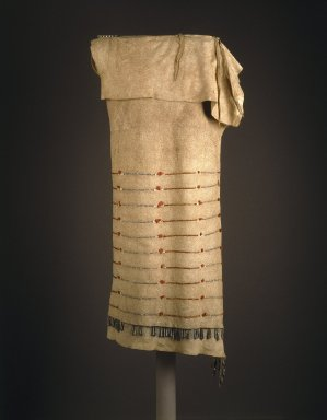 Yankton, Nakota, Sioux. <em>Sidefold Dress</em>, early 19th century. Buffalo hide (?) dyed bird and porcupine quills, copper, tinned iron and copper cones, pony glass beads, yarn, pigment, sinew, thong, 50 x 16 in. (127 x 40.6 cm). Brooklyn Museum, Henry L. Batterman Fund and Frank Sherman Benson Fund, 50.67.6. Creative Commons-BY (Photo: Brooklyn Museum, 50.67.6_SL1.jpg)