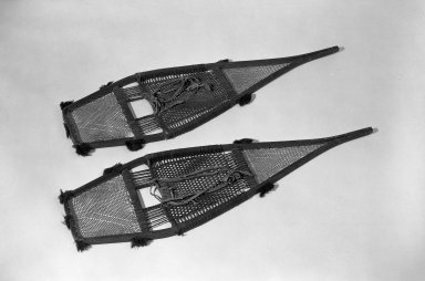Chippewa (Anishinaabe). <em>Snow Shoes</em>, early 19th century. Wood, cloth, yarn, 41 1/4 x 12 1/4 in. (104.8 x 31.1 cm). Brooklyn Museum, Henry L. Batterman Fund and the Frank Sherman Benson Fund, 50.67.76a-b. Creative Commons-BY (Photo: Brooklyn Museum, 50.67.76a-b_acetate_bw.jpg)