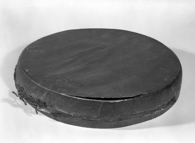 Chippewa (Anishinaabe). <em>Two-headed Drum</em>, 1801-1848. Hide, wood, pigment, 2 3/4 x 15 x 15 in. (7 x 38.1 x 38.1 cm). Brooklyn Museum, Henry L. Batterman Fund and the Frank Sherman Benson Fund, 50.67.79. Creative Commons-BY (Photo: Brooklyn Museum, 50.67.79_view1_bw.jpg)