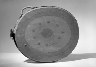 Great Lakes. <em>Double-headed Drum</em>, early 19th century. Hide, wood, pigment, 19 7/8 x 2 1/2 x 16 1/8 in. (50.5 x 6.4 x 41 cm). Brooklyn Museum, Henry L. Batterman Fund and the Frank Sherman Benson Fund, 50.67.81. Creative Commons-BY (Photo: Brooklyn Museum, 50.67.81_acetate_bw.jpg)
