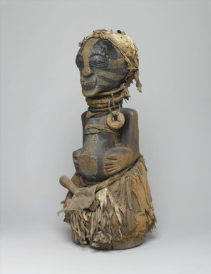 Songye. <em>Power Figure (Nkishi)</em>, late 19th or early 20th century. Wood, raffia, metal, cloth, leather, horn, beads, 30 x 12 x 14 3/4 in. (76.2 x 30.5 x 37.5 cm). Brooklyn Museum, Museum Collection Fund, 50.79. Creative Commons-BY (Photo: Brooklyn Museum, 50.79_threequarter_PS1.jpg)