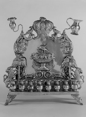 B. Szkarlad. <em>Hanukkah Lamp</em>, ca. 1900. Silver, 10 3/4 x 10 1/8 x 3 1/4 in. (27.3 x 25.7 x 8.3 cm). Brooklyn Museum, Gift of Mrs. William Linder in memory of Dr. William Linder, 50.7. Creative Commons-BY (Photo: Brooklyn Museum, 50.7_bw.jpg)