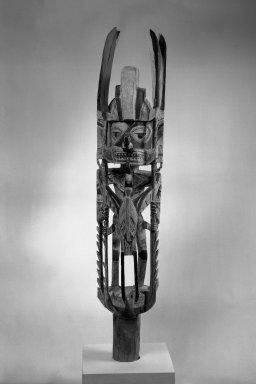 <em>Figure (Totok)</em>, 19th or early 20th century. Wood, Turbo petholatus opercula, pigment, 44 1/2 x 8 x 7 3/4 in. (113 x 20.3 x 19.7 cm). Brooklyn Museum, Gift of John W. Vandercook, 51.118.3. Creative Commons-BY (Photo: Brooklyn Museum, 51.118.3_acetate_bw.jpg)