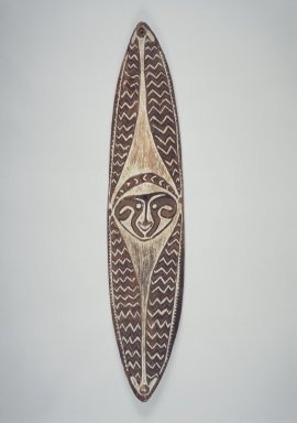 Era River. <em>Carved and Painted Board (Gope)</em>, early 20th century. Wood, natural pigments, 53 x 11 x 2 1/2 in. (134.6 x 27.9 x 6.4 cm). Brooklyn Museum, Gift of John W. Vandercook, 51.118.5. Creative Commons-BY (Photo: Brooklyn Museum, 51.118.5.jpg)