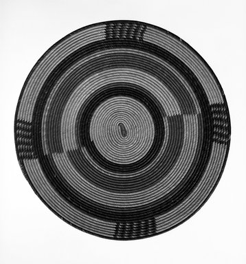 Hausa. <em>Flat Basketry Cover for a Pot</em>, early 20th century. Vegetal fiber, diam: 15 3/4 in. (40.0 cm). Brooklyn Museum, Gift of John W. Vandercook, 51.140.23. Creative Commons-BY (Photo: Brooklyn Museum, 51.140.23_bw.jpg)