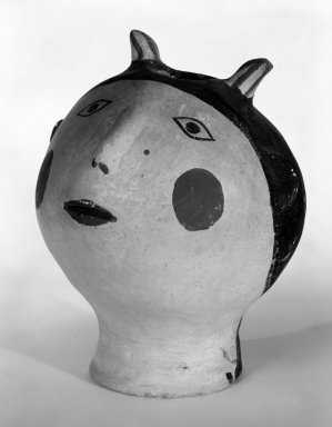 Haak'u (Acoma Pueblo). <em>Head with Opening at Top</em>, mid-20th century. Clay, pigment, 5 1/2 x 4 5/16 in. (14 x 11 cm). Brooklyn Museum, Gift of Mary Johnson, 51.243.14. Creative Commons-BY (Photo: Brooklyn Museum, 51.243.14_bw.jpg)