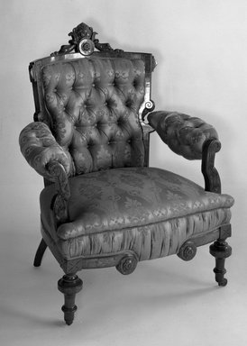 Thomas Brooks (American, 1811-1887). <em>Armchair</em>, 1872. Walnut, modern upholstery, 38 1/4 x 32 1/2 x 31 in. (97.2 x 82.6 x 78.7 cm). Brooklyn Museum, Gift of Dr. Dorothea E. Curnow, 52.120. Creative Commons-BY (Photo: Brooklyn Museum, 52.120_acetate_bw.jpg)