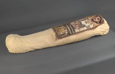<em>Cartonnage and Mummy of an Anonymous Man</em>, 3rd century C.E. Human remain, wood (Ficus sycomorus, sycomore fig), grass, linen, plaster, pigment, a: cartonnage: 13 1/4 x 35 7/16 in. (33.7 x 90.0 cm). Brooklyn Museum, Charles Edwin Wilbour Fund, 52.128a-e. Creative Commons-BY (Photo: Brooklyn Museum, 52.128a_52.128e_PS2.jpg)