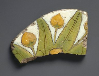<em>Tile Fragment with Mandragora Fruit and Leaves</em>, 1352-1336 B.C.E. Faience, 2 15/16 × 5 5/16 in. (7.5 × 13.5 cm). Brooklyn Museum, Charles Edwin Wilbour Fund, 52.148.2. Creative Commons-BY (Photo: Brooklyn Museum, 52.148.2_SL1.jpg)