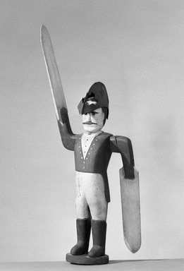 <em>Whirligig Weathervane, Figure of a Wooden Soldier</em>. painted wood, metal, 29 x 9 x 5 in. (73.7 x 22.9 x 12.7 cm). Brooklyn Museum, Gift of Mr. and Mrs. Edgar W. Garbisch, 52.168.1. Creative Commons-BY (Photo: Brooklyn Museum, 52.168.1_acetate_bw.jpg)