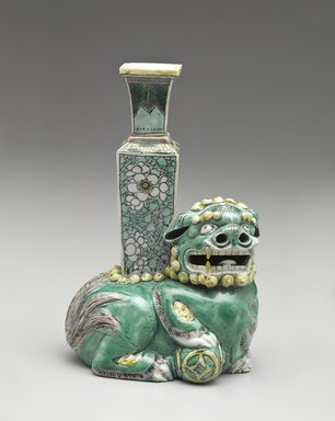 <em>Crouching Fu-dog Supporting Vase</em>, 1662-1722. Porcelain with three-color (sancai) glaze, 7 3/8 x 4 7/8 x 3 1/2 in. (18.7 x 12.4 x 8.9 cm). Brooklyn Museum, The William E. Hutchins Collection, Bequest of Augustus S. Hutchins, 52.49.38. Creative Commons-BY (Photo: Brooklyn Museum, 52.49.38_PS6.jpg)