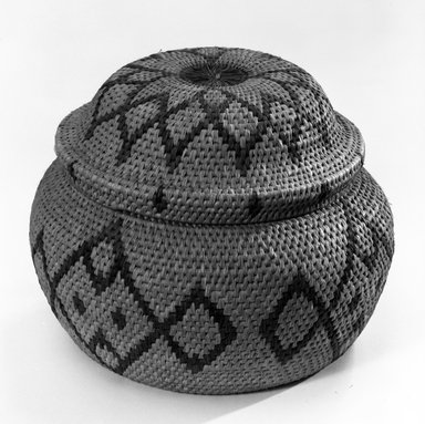Possibly Zulu. <em>Basket with Cover</em>, 19th century. Vegetable fiber, lid: 5 1/2 x 7 3/8 in. (14 x 18.7 cm). Brooklyn Museum, Bequest of Mrs. George Hadden, 52.80.3a-b. Creative Commons-BY (Photo: Brooklyn Museum, 52.80.3a-b_bw.jpg)