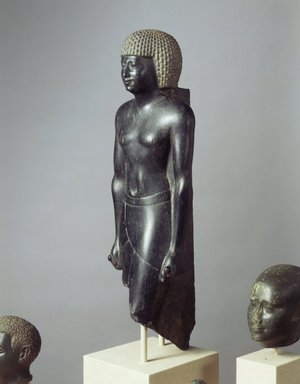 <em>Statue of a Priest of Amun</em>, 381-362 B.C.E. Diorite, 20 1/16 x 6 1/4 x 5 1/2 in., 30 lb. (51 x 15.9 x 14 cm, 13.61kg). Brooklyn Museum, Charles Edwin Wilbour Fund, 52.89. Creative Commons-BY (Photo: Brooklyn Museum, 52.89_view2_SL4.jpg)