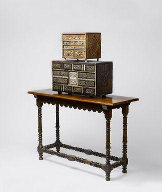 <em>Table Cabinet (Contador)</em>, mid 17th century. Wood, bone, ivory, tortoiseshell, and metal (with modern feet), 13 3/4 x 27 x 11 1/2 in. (34.9 x 68.6 x 29.2 cm). Brooklyn Museum, Frank L. Babbott Fund, Frank Sherman Benson Fund, Carll H. de Silver Fund, A. Augustus Healy Fund, Caroline A.L. Pratt Fund, Charles Stewart Smith Memorial Fund, and Ella C. Woodward Memorial Fund, 48.206.92. Creative Commons-BY (Photo: , 53.11.8_48.206.92_EL95.08_PS6.jpg)