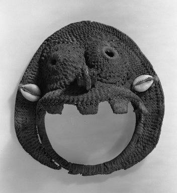 <em>Ovoid Mask</em>, late 19th century. Woven basketry, 5 11/16 x 5 5/16 in. (14.5 x 13.5 cm). Brooklyn Museum, Gift of Julius Carlebach, 53.150.1. Creative Commons-BY (Photo: Brooklyn Museum, 53.150.1_acetate_bw.jpg)