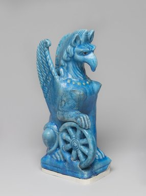 <em>Statuette of Nemesis in Form of Female Griffin with Wings</em>, 2nd century C.E. Faience, 9 3/16 x 2 13/16 x 4 3/16 in. (23.4 x 7.2 x 10.7 cm). Brooklyn Museum, Charles Edwin Wilbour Fund, 53.173. Creative Commons-BY (Photo: , 53.173_PS9.jpg)