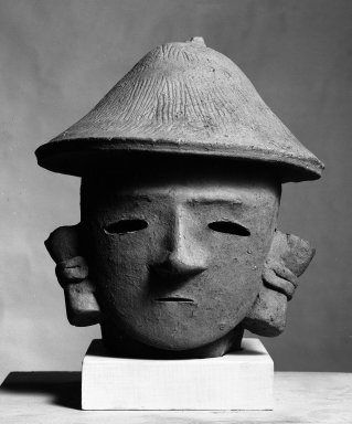 <em>Head of a Man with a Cap</em>, 3rd-5th century. Clay, 7 7/8 x 6 5/16 x 6 13/16 in. (20 x 16 x 17.3 cm). Brooklyn Museum, Museum Collection Fund, 53.251. Creative Commons-BY (Photo: Brooklyn Museum, 53.251_bw.jpg)