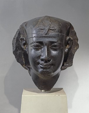 <em>Head of a Ptolemaic King</em>, 3rd century B.C.E. (probably). Basalt, 16 x 16 1/2 x 16 in. (40.6 x 41.9 x 40.6 cm). Brooklyn Museum, Charles Edwin Wilbour Fund, 53.75. Creative Commons-BY (Photo: Brooklyn Museum, 53.75_front_SL1.jpg)