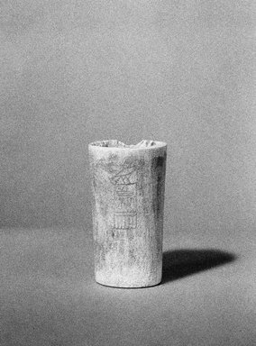 <em>Cylinder Inscribed with a King's Name</em>, ca. 2800-2780 B.C.E. Bone, 2 1/4 x Diam. 1 5/16 in. (5.7 x 3.3 cm). Brooklyn Museum, Charles Edwin Wilbour Fund, 53.79. Creative Commons-BY (Photo: Brooklyn Museum, 53.79_view1_bw_SL1.jpg)