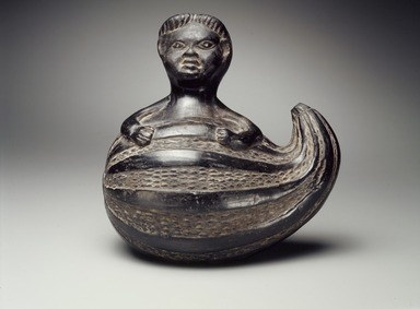 Chimú. <em>Effigy Vessel in Form of a Human Figure Emerging from a Gourd</em>, 17th or 18th century (possibly). Ceramic, 8 1/2 x 8 1/2 x 6 in. (21.6 x 21.6 x 15.2 cm). Brooklyn Museum, Gift of Florence Walker, 53.97.1. Creative Commons-BY (Photo: Brooklyn Museum, 53.97.1.jpg)