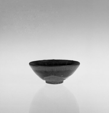 <em>Bowl</em>, 1127-1279. High-fired ware with black glaze, 1 1/2 x 3 11/16 in. (3.8 x 9.4 cm). Brooklyn Museum, Gift of David James in memory of his brother, William James, 54.10.5. Creative Commons-BY (Photo: Brooklyn Museum, 54.10.5_bw.jpg)