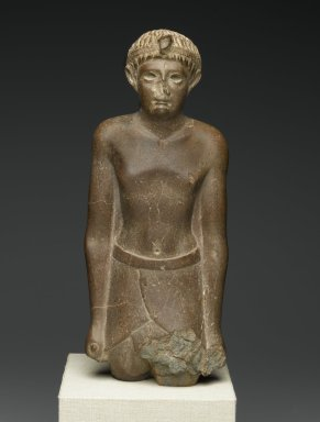 <em>Ptolemaic Prince</em>, 51-30 B.C.E. Quartzite, 12 1/2 x 5 5/16 x 3 3/8 in. (31.8 x 13.5 x 8.5 cm). Brooklyn Museum, Charles Edwin Wilbour Fund, 54.117. Creative Commons-BY (Photo: Brooklyn Museum, 54.117_front_PS2.jpg)