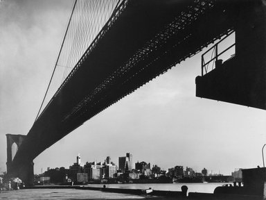 Harold Corsini (American, 1919-2008). <em>New York Harbor, Brooklyn Bridge Spanning the East River as Seen from Pier on Manhattan Side, November 1946</em>, 1946. Gelatin silver photograph, 10 1/8 x 13 1/8 in. (25.7 x 33.3 cm). Brooklyn Museum, Gift of Standard Oil Company, New Jersey, 54.201.2. © artist or artist's estate (Photo: Brooklyn Museum, 54.201.2.jpg)