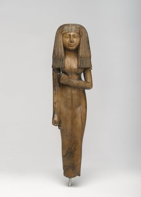 <em>Statuette of a Woman</em>, ca. 1390-1353 B.C.E. Wood, 10 1/16 x 2 3/4 x 1 7/8 in. (25.6 x 7 x 4.8 cm). Brooklyn Museum, Charles Edwin Wilbour Fund, 54.29. Creative Commons-BY (Photo: Brooklyn Museum, 54.29_PS4.jpg)