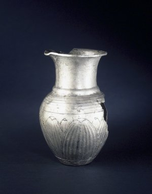 <em>Jar with Floral Decoration</em>, ca. 410 B.C.E. Silver, molded, 3 3/8 × 6 15/16 in. (8.5 × 17.7 cm). Brooklyn Museum, Charles Edwin Wilbour Fund, 54.50.39. Creative Commons-BY (Photo: Brooklyn Museum, 54.50.39_transp5433.jpg)