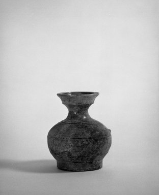 <em>Miniature Vase (hu shape)</em>, 200 B.C.E.-300 C.E. Buff clay, 4 15/16 x 4 3/16 in. (12.6 x 10.7 cm). Brooklyn Museum, Museum Collection Fund, 54.52. Creative Commons-BY (Photo: Brooklyn Museum, 54.52_bw.jpg)