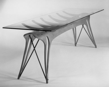 Carlo Mollino (Italian, 1905-1973). <em>Dining Room Table</em>, ca. 1950. Molded maple Plywood, glass, Without glass top: 30 x 92 1/2 x 26 1/2 in. (76.2 x 235 x 67.3 cm). Brooklyn Museum, Gift of the Italian Government, 54.64.232a-b. Creative Commons-BY (Photo: Brooklyn Museum, 54.64.232_bw_SL1.jpg)