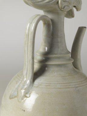 <em>Ewer with Phoenix Head</em>, ca. 10th century. Qingbai ware, stoneware, translucent glaze, height: 14 9/16 in. (37 cm); diameter: 6 7/8 in. (17.5 cm). Brooklyn Museum, Ella C. Woodward Memorial Fund and Frank L. Babbott Fund, 54.7. Creative Commons-BY (Photo: Brooklyn Museum, 54.7_detail_03_PS9.jpg)