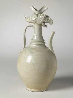 <em>Ewer with Phoenix Head</em>, ca. 10th century. Qingbai ware, stoneware, translucent glaze, height: 14 9/16 in. (37 cm); diameter: 6 7/8 in. (17.5 cm). Brooklyn Museum, Ella C. Woodward Memorial Fund and Frank L. Babbott Fund, 54.7. Creative Commons-BY (Photo: Brooklyn Museum, 54.7_side_right_PS9.jpg)