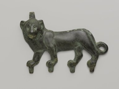 <em>Lion Applique</em>, 4th-3rd century B.C.E. Bronze, 4 3/16 x 7 3/8 in. (10.7 x 18.8 cm). Brooklyn Museum, Charles Edwin Wilbour Fund, 55.141. Creative Commons-BY (Photo: Brooklyn Museum, 55.141_PS9.jpg)