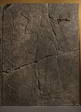 Assyrian. <em>Apkallu-figure</em>, ca. 883-859 B.C.E. Gypsum stone, pigment, 93 7/16 x 68 11/16 in. (237.3 x 174.5 cm). Brooklyn Museum, Purchased with funds given by Hagop Kevorkian and the Kevorkian Foundation, 55.148. Creative Commons-BY (Photo: Brooklyn Museum, 55.148_PS11.jpg)
