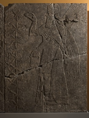 Assyrian. <em>Apkallu-figure</em>, ca. 883-859 B.C.E. Gypsum stone, pigment, 93 7/16 x 68 11/16 in. (237.3 x 174.5 cm). Brooklyn Museum, Purchased with funds given by Hagop Kevorkian and the Kevorkian Foundation, 55.148. Creative Commons-BY (Photo: Brooklyn Museum, 55.148_at_PS11.jpg)