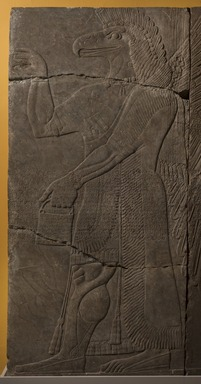 Assyrian. <em>Apkallu-figure</em>, ca. 883-859 B.C.E. Gypsum stone, pigment, 90 9/16 x 42 3/16 in. (230 x 107.2 cm). Brooklyn Museum, Purchased with funds given by Hagop Kevorkian and the Kevorkian Foundation, 55.149. Creative Commons-BY (Photo: Brooklyn Museum, 55.149_PS11.jpg)