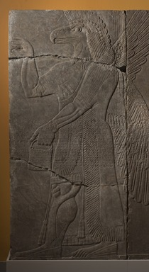 Assyrian. <em>Apkallu-figure</em>, ca. 883-859 B.C.E. Gypsum stone, pigment, 90 9/16 x 42 3/16 in. (230 x 107.2 cm). Brooklyn Museum, Purchased with funds given by Hagop Kevorkian and the Kevorkian Foundation, 55.149. Creative Commons-BY (Photo: Brooklyn Museum, 55.149_at_PS11.jpg)