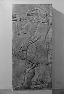 Assyrian. <em>Apkallu-figure</em>, ca. 883-859 B.C.E. Alabaster, 90 9/16 x 42 3/16 in. (230 x 107.2 cm). Brooklyn Museum, Purchased with funds given by Hagop Kevorkian and the Kevorkian Foundation, 55.149. Creative Commons-BY (Photo: , 55.149_bw_SL1.jpg)