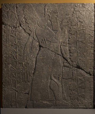 Assyrian. <em>Apkallu-figure Fertilizing the Sacred Tree</em>, ca. 883-859 B.C.E. Alabaster, 90 1/2 x 78 15/16 in. (229.8 x 200.5 cm). Brooklyn Museum, Purchased with funds given by Hagop Kevorkian and the Kevorkian Foundation, 55.151. Creative Commons-BY (Photo: Brooklyn Museum, 55.151_PS11.jpg)
